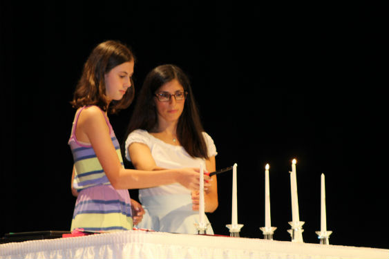 SHMS students light candles in National Junior Honor Society Induction Ceremony.