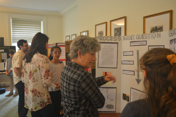 Fifth-grade students present research at gallery walk .