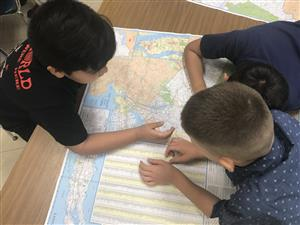 Students working with maps