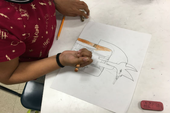 student drawing Egyptian art