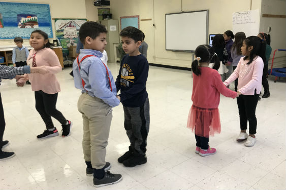 Students learn more of the music genre Bachata in their FLES class.