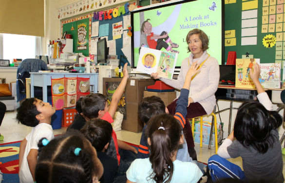 Author reads her book that reveals emotions to Morse students.