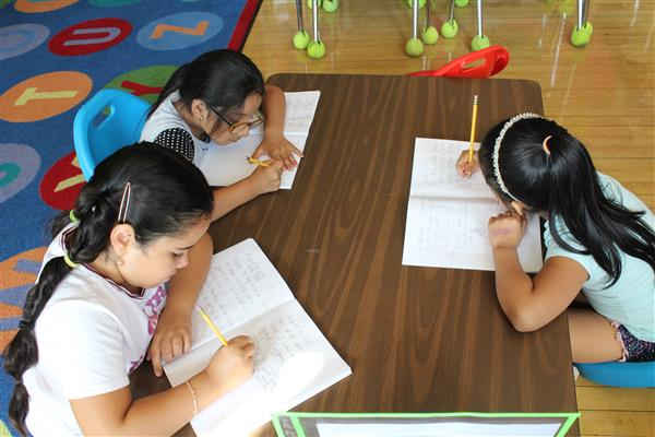 Students engage in literacy activities during this summer program at Morse.
