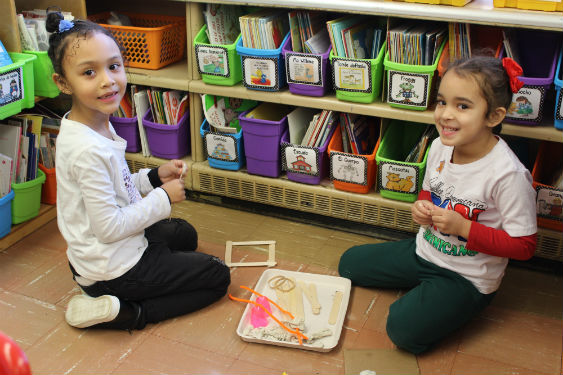 Kindergarten students use STEM skills to build trap to catch a gingerbread man.
