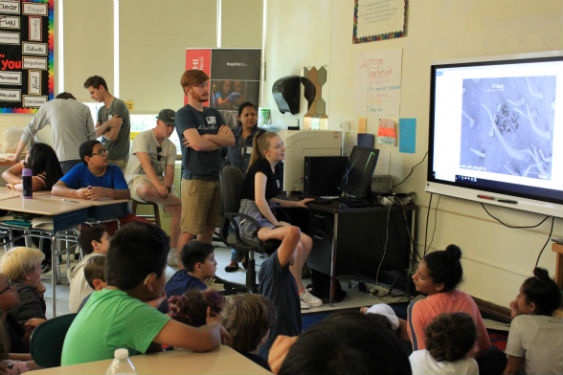 AP Chemistry students teach younger students at Washington Irving how to use an electron microscope