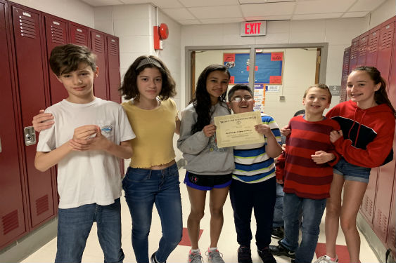 Middle School students honored for their Lunch Buddy Program.