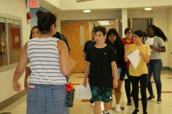 SHHS students conduct a scavenger hunt at Freshman Orientation.